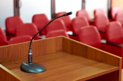before a conference, the microphone in front of empty chairs.© poplasen - Fotolia.com