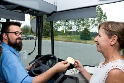 Busdriver and paying Woman laughing © Michael Schütze - Fotolia.com