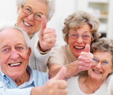 Success - Older people giving thumbs up © Yuri Arcurs - Fotolia.com