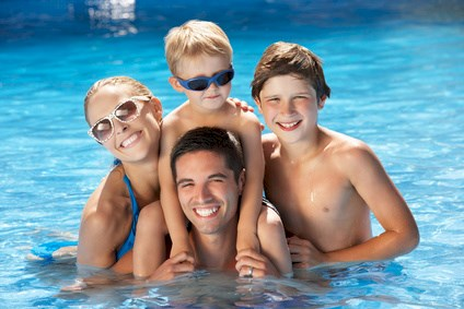 Family Having Fun In Swimming Pool © Monkey Business - Fotolia.com