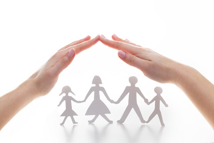Paper family under hands in gesture of protection. © Photocreo Bednarek  Fotolia.com