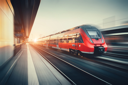 Beautiful railway station with modern red commuter train at suns © den-belitsky - Fotolia_117524744_XS.jpg