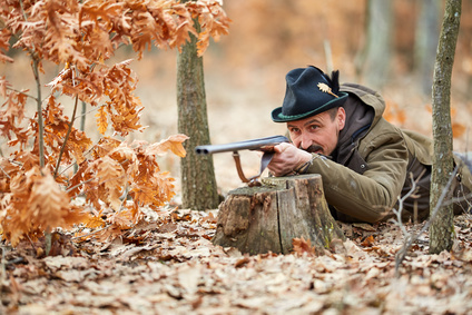 Hunter with gun in the forest © xalanx - Fotolia_200747677_XS.jpg